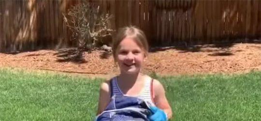Video Screenshot - volunteer with bag in grass